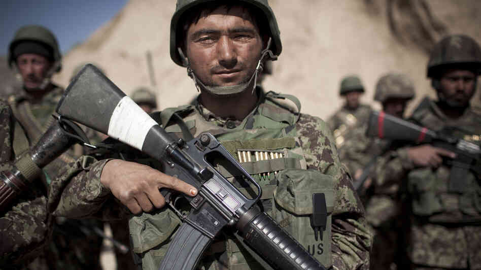 Afghan army soldiers, like the one pictured here, will be responsible for protecting Kabul and holding critical cities and roads toge