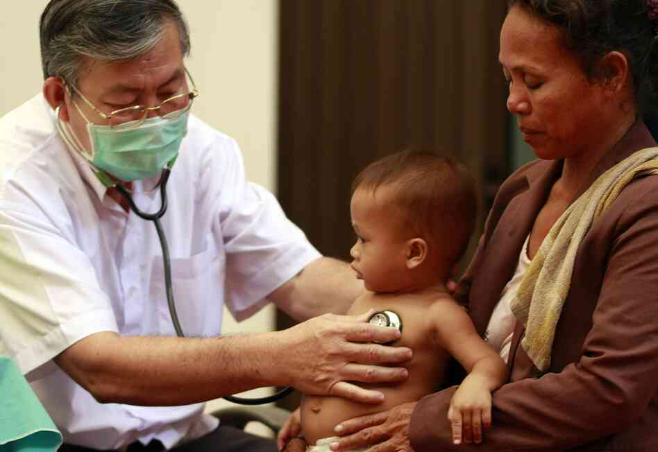 A Cambodian doctor examines a child at Kantha Bopha Children's Hospital in Phnom Penh.
