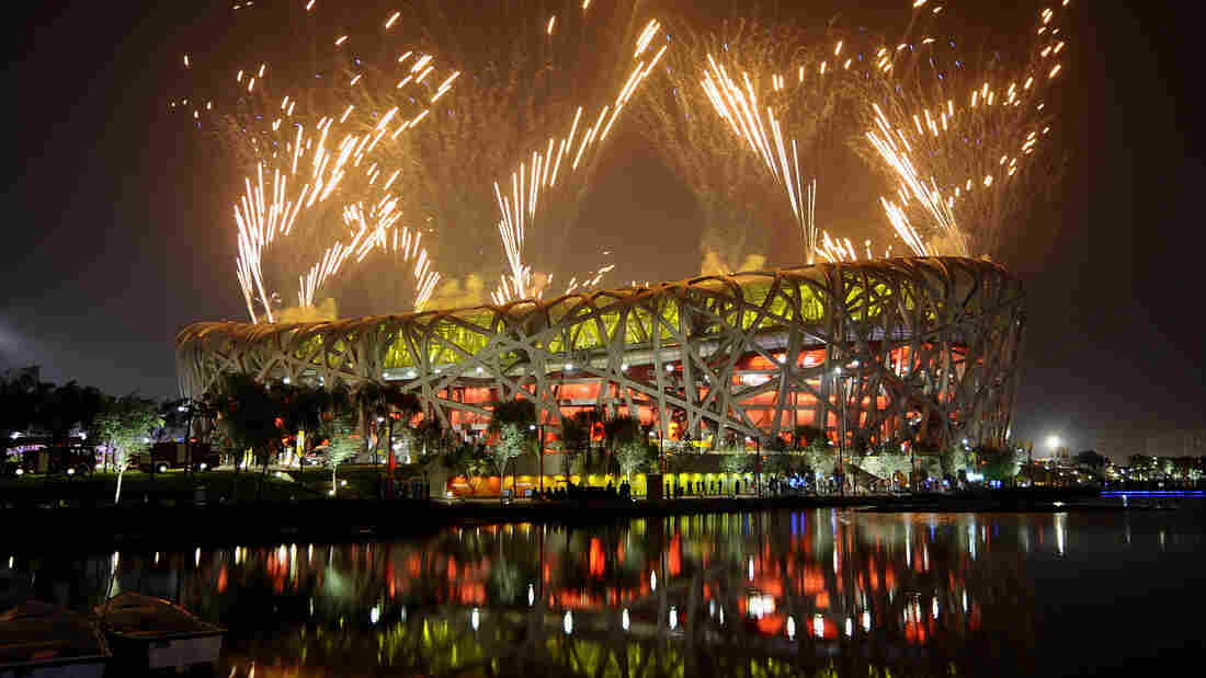 Fireworks light the night sky above the National Stadium, known as the Bird's Nest, during the closing ceremony of the 2008 Beijing Olympic Games. The stadium is largely empty these days.