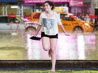 Dancing in the rain: New York City got some relief from the heat as early as Saturday, when this young woman danced in the rain in Times Square.