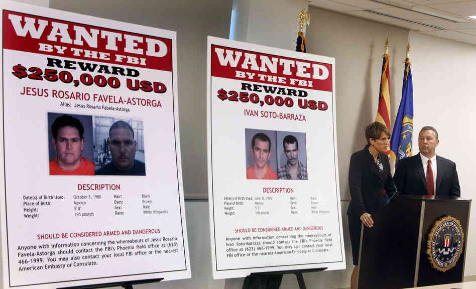 With wanted posters off to the side, James L. Turgal, Jr., right, FBI Special Age