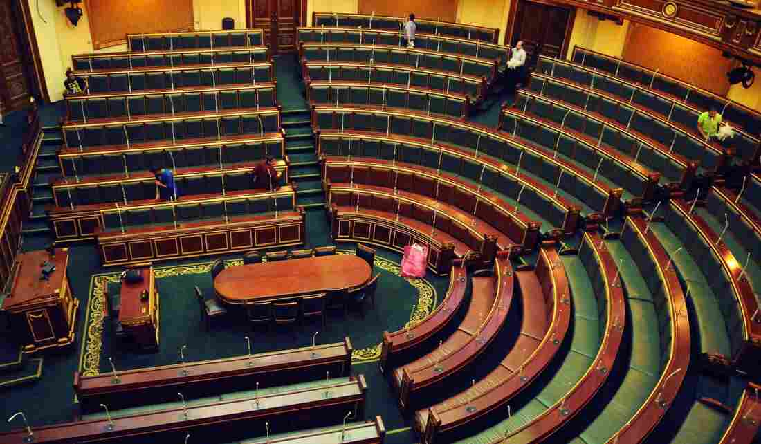 Workers clean inside the Egyptian parliament in Cairo on Monday.