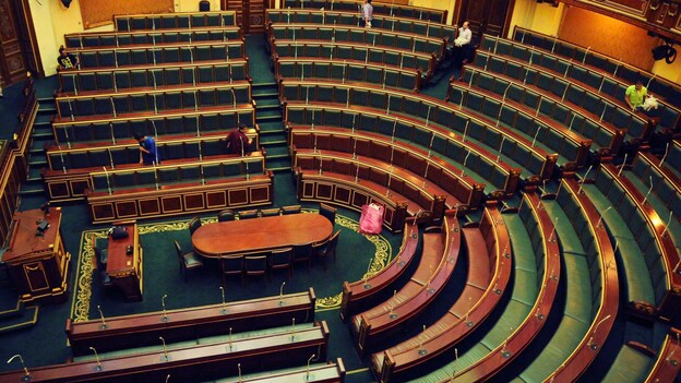 Workers clean inside the Egyptian parliament in Cairo on Monday. (AP)