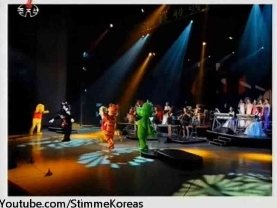 An image from a video posted by StimmeKoreas, which in turn came from North Korea official media, showing some of the dancing (fake) Disney characters at Friday's performance.