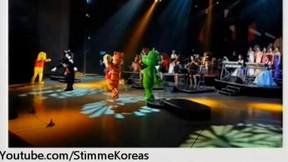 An image from a video posted by StimmeKoreas, which in turn came from North Korea official media, showing some of the dancing (fake) Disney characters at Friday's performance. (YouTube.com )