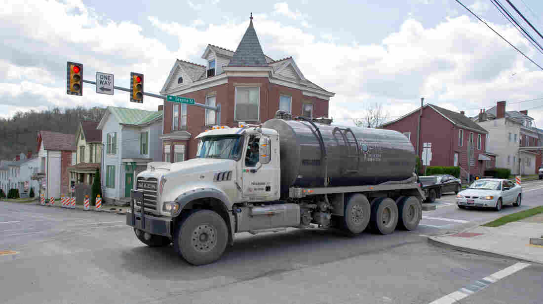 A water tank truck is seen on the main street in Waynesburg, Pa., on April 13. Scientists say naturally polluted water can rise to the surface of the Marcellus Shale; that finding suggests that frack water could seep out, too.