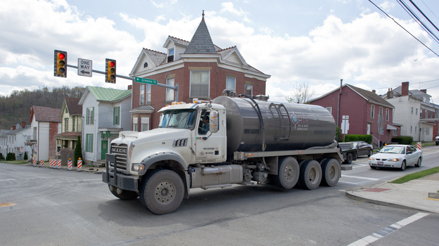 A water tank truck is seen on the main street in Waynesburg, Pa., on April 13. Scientists say naturally polluted water can rise to the surface of the Marcellus Shale; that finding suggests that frack water could seep out, too. (AFP/Getty Images)
