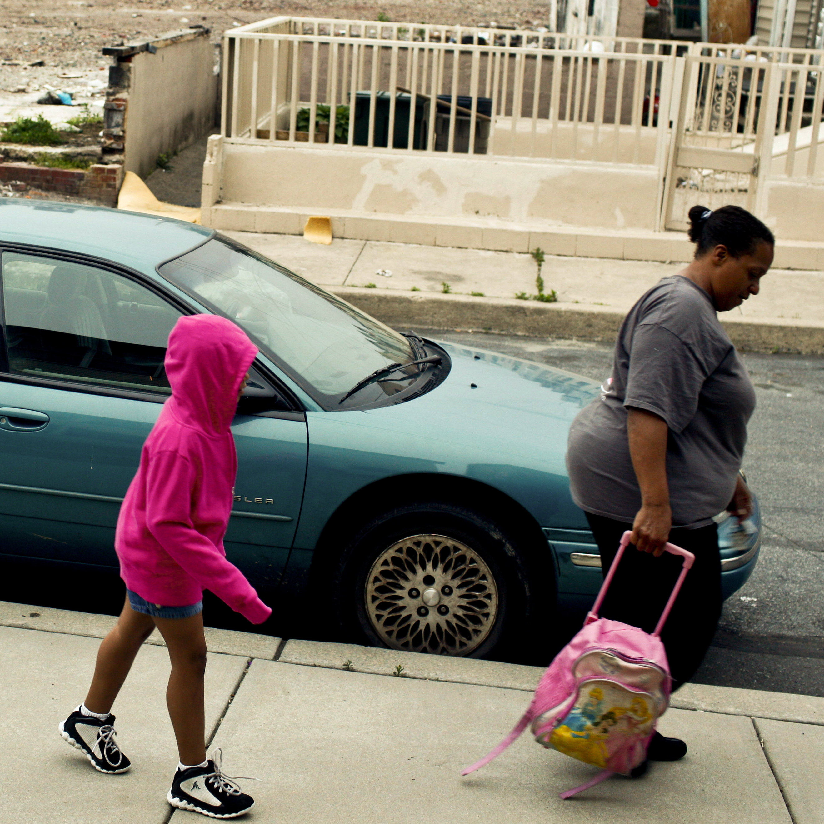 Tracy Boggs, 49, walks her daughter Emily, 7, to the Second Street Learning Center in Reading, Pa.