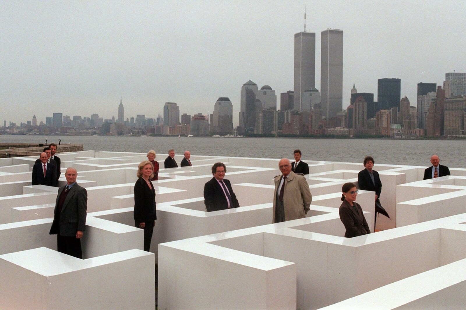 Prominent Jewish-Americans, including Ginsburg, pose for a photograph while standing in a maze on Ellis Island in New York on Sept. 18, 1996, as part of a project by Frederic Brenner.