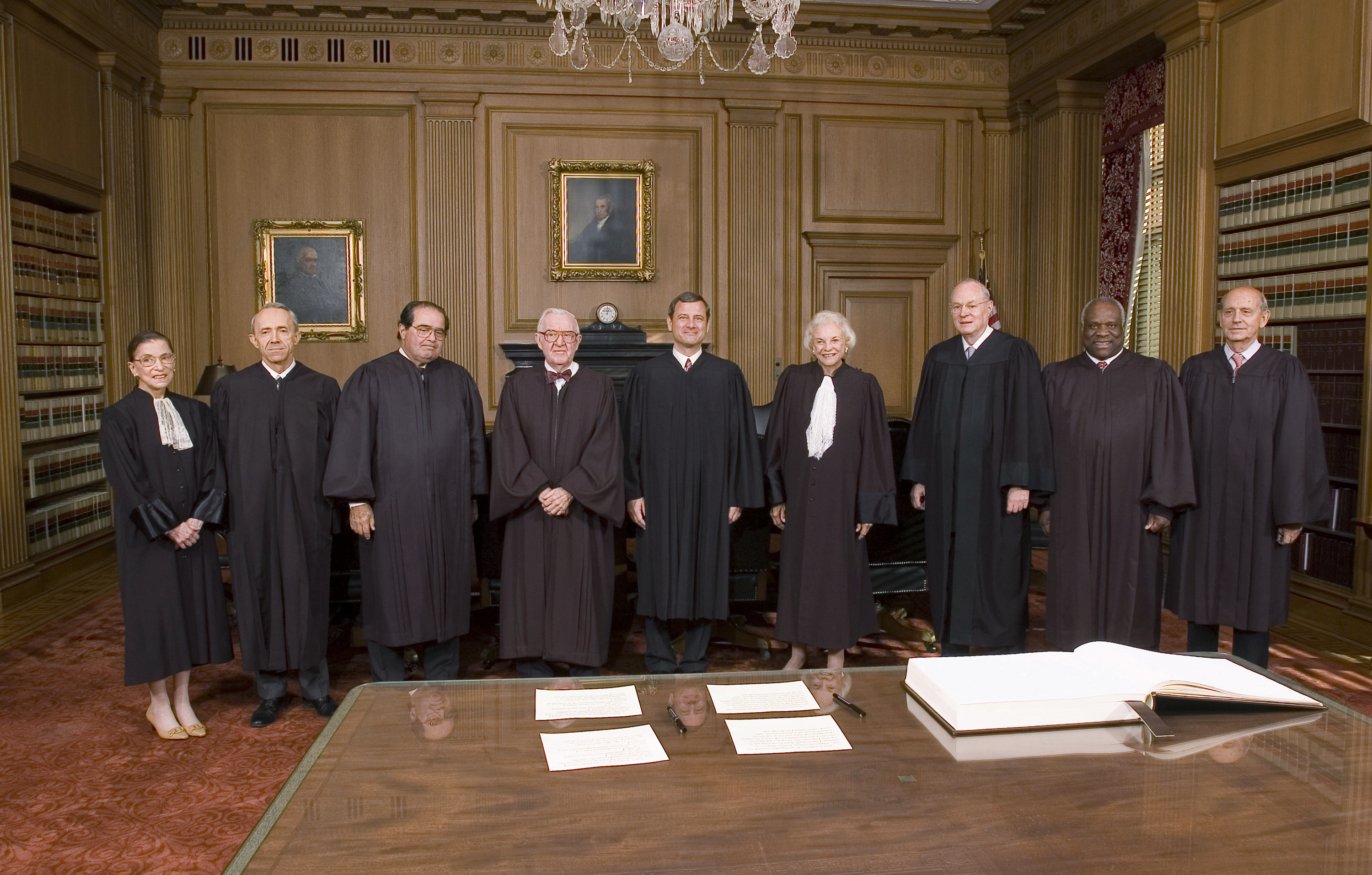 John Roberts (center) with the rest of the court after becoming chief justice on Oct. 3, 2005. The other justices pictured are Ginsburg (from left), David Souter, Antonin Scalia, John Paul Stevens, Roberts, Sandra Day O'Connor, Anthony Kennedy, Clarence Thomas and Stephen Breyer.
