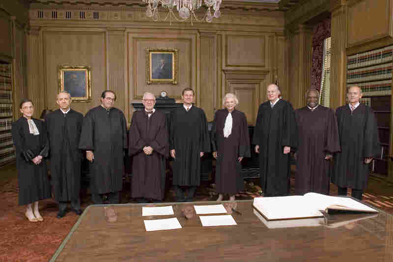 John Roberts (center) poses with the rest of the court after becoming chief justice, on Oct. 3, 2005. The other justices pictured are Ginsburg (from left), David Souter, Antonin Scalia, John Paul Stevens, Roberts, Sandra Day O'Connor, Anthony Kennedy, Clarence Thomas and Stephen Breyer.