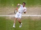 Andy Murray returns a shot during the men's final match at Wimbledon. A pair of tickets for the match went for £32,000 (about $50,000).