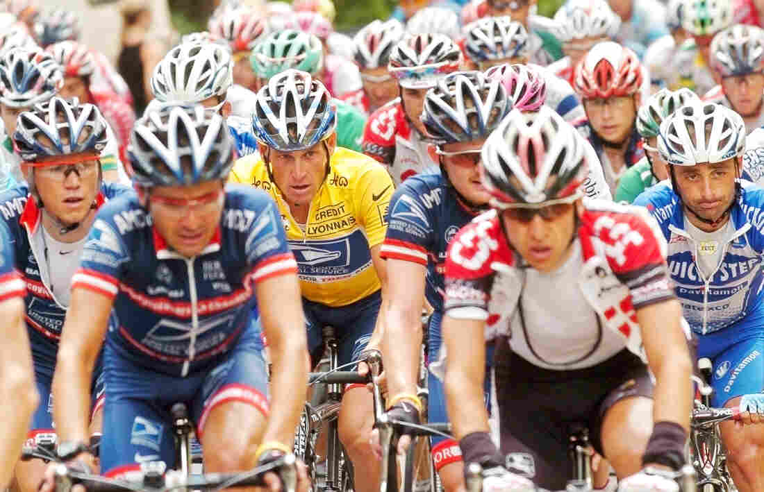 Lance Armstrong, rear left in yellow jersey, rides in the pack flanked by his US Postal Service teammates during the 18th stage of the Tour de France in 2004.