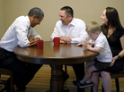 President Obama meets with Jason and Ali McLaughlin and their son, Cooper, while visiting their home in Cedar Rapids, Iowa.
