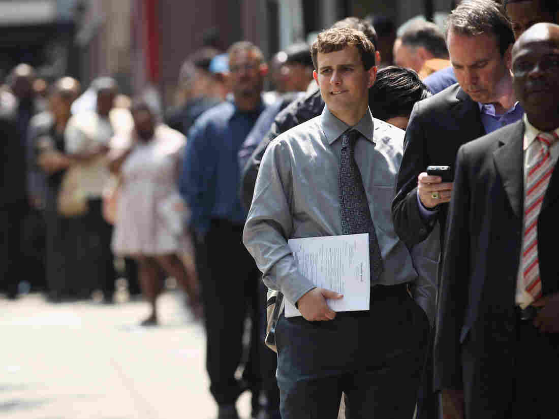 Applicants wait to enter a job fair in New York City last month.
