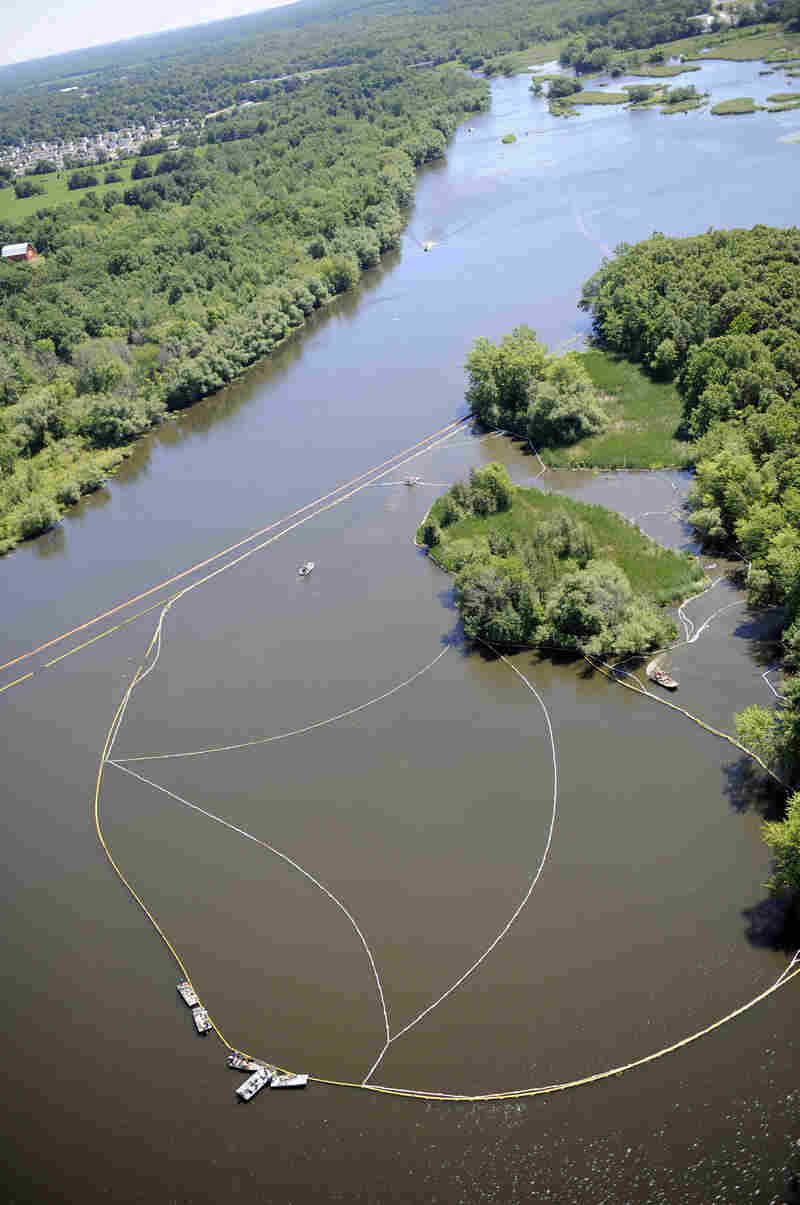 Cleanup work continues on the Kalamzoo River almost a year after the oil spill.
