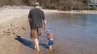 Loudon Wainwright III at the beach with his grandson Archangelo, the son of Martha Wainwright.