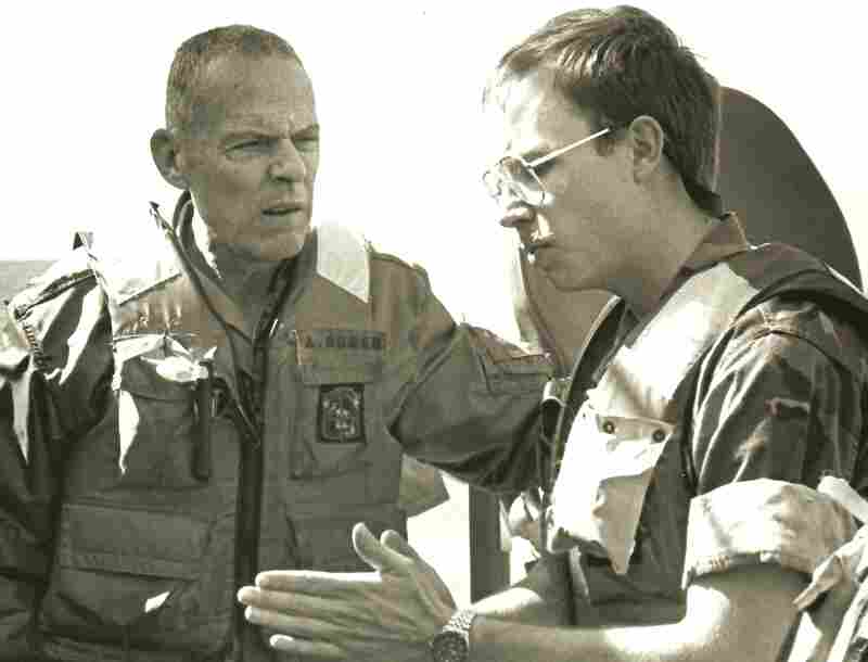 David Crist's father, George (left), discusses operations against Iranian attack boats with Navy Lt. Paul Hillenbrand. George Crist, a Marine Corps general, was commander of CENTCOM from 1985-1988.