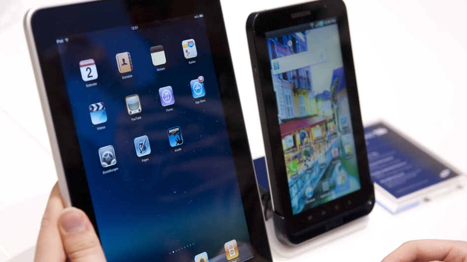 "Samsung won a victory Monday in its global patent war with Apple. The British judge said Samsung's Galaxy Tab (right) is ""not as cool"" as the iPad (left). (AP)"