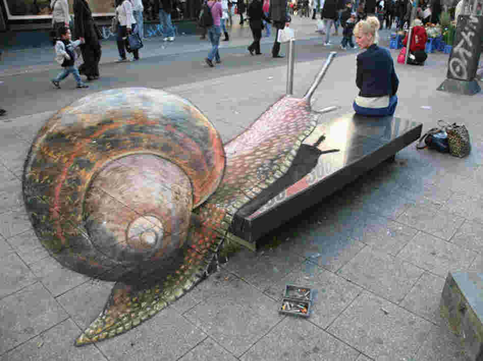 A snail on a city bench.