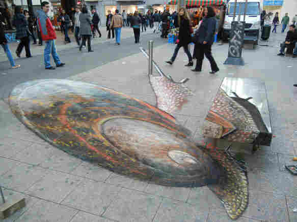Snail pavement drawing viewed from the wrong perspective.