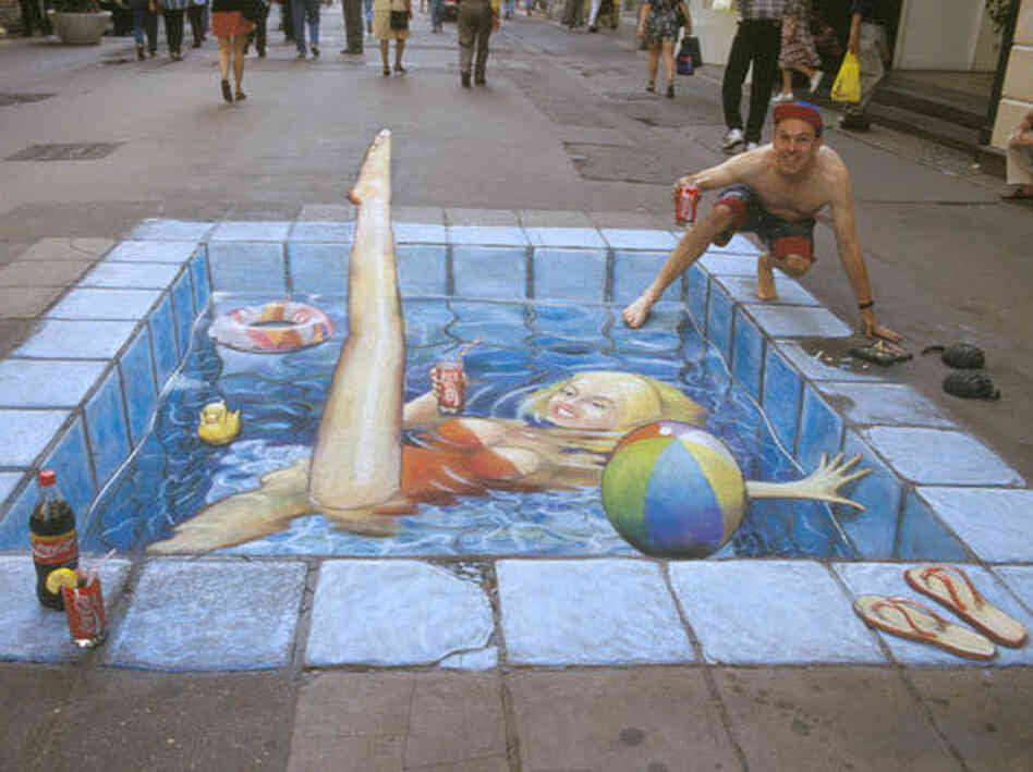 A swimming pool made of chalk in the middle of the street.