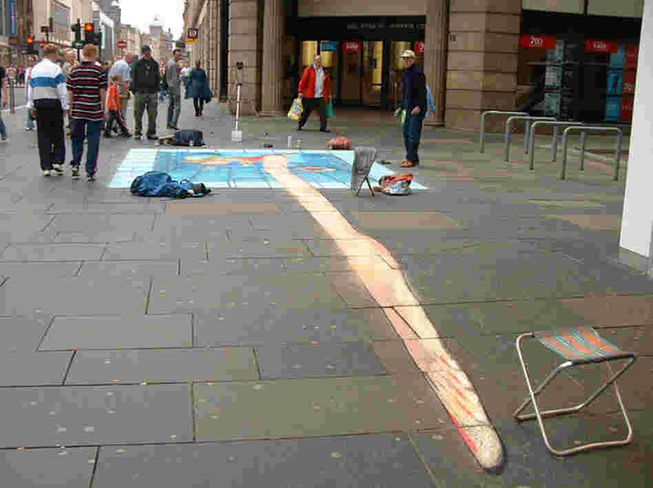 A pavement drawing of a woman in a pool viewed from the wrong angle.