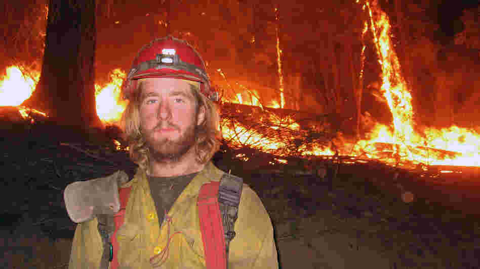 Firefighter John Lauer, seen at the scene of a wildfire in Montana, led a campaign for health coverage of seasonal firefighters and their families.
