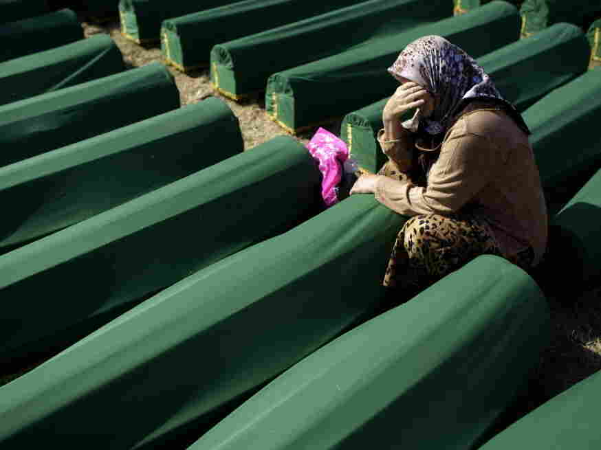 Earlier today, a woman cried next to the coffin of her relative at the Potocari memorial complex near Srebrenica.