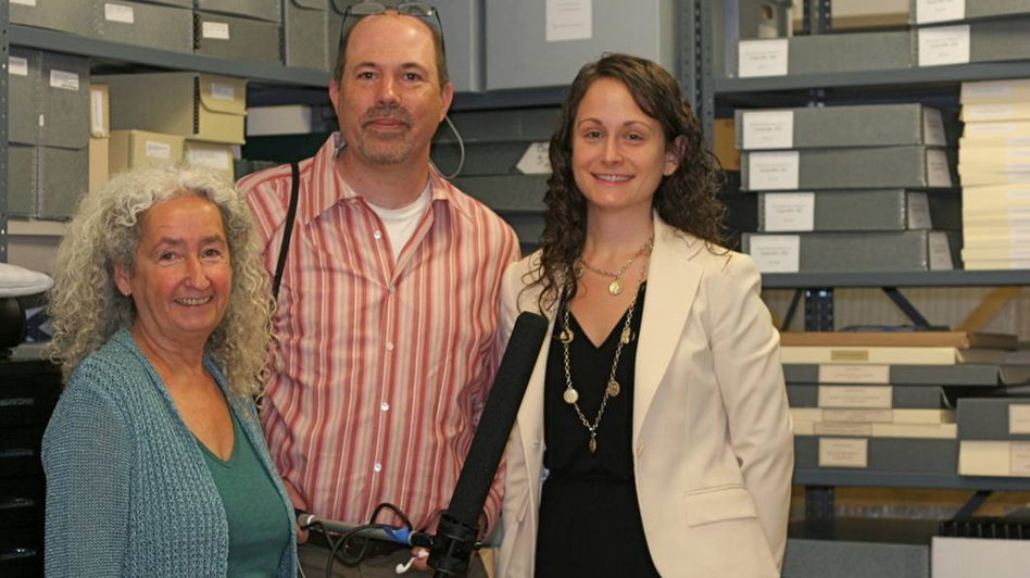 Reporter Bradley Klein stands with Nora Guthrie (left), director of the Woody Guthrie Foundation, and archivist Tiffany Colannino (right). (Twangbox Productions)