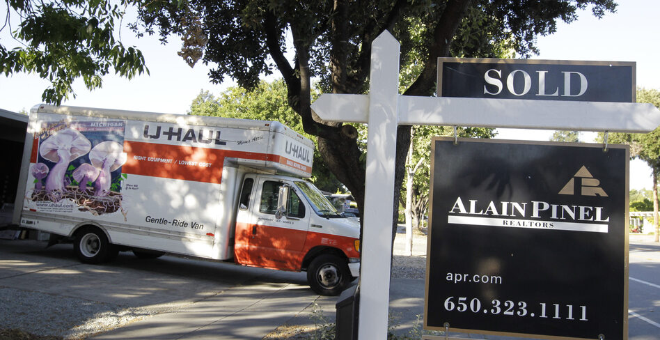 A moving truck is shown at a house that was sold in Palo Alto, Calif. on Tuesday.