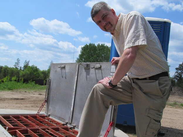 Brainerd Public Utilities' Scott Sjolund at a sewer site. Sewers around the city were monitored to gauge the amount of potential energy flowing through the system.
