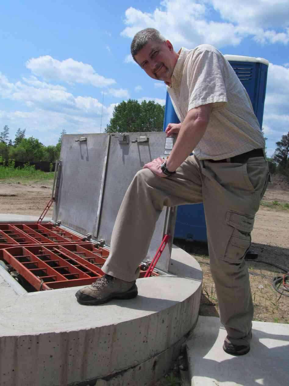 Brainerd Public Utilities' Scott Sjolund at a sewer site. Sewers around the city were monitored to gauge the amount of potential energy flowi