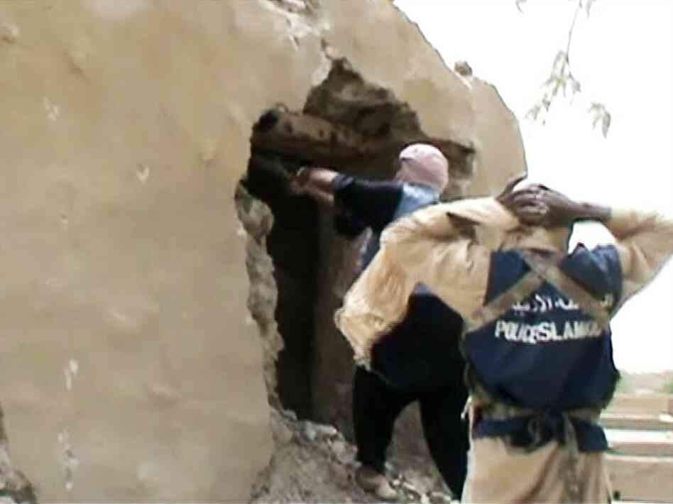 A still from a video shows Islamist militants destroying an ancient shrine in Timbuktu on July 1. The militants, who seized control of Timbuktu along with the rest of northern Mali three months ago, consider the shrines to be idolatrous.