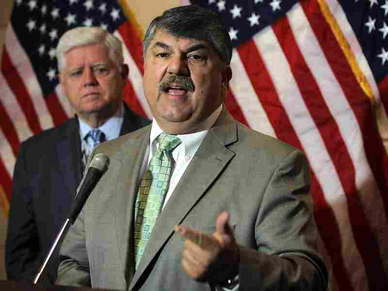 AFL-CIO President Richard Trumka (R) speaks as House Democratic Caucus Chairman Rep. John Larson, D-CT, (L) listens during a news briefing after a closed caucus meeting June 27 on Capitol Hill.