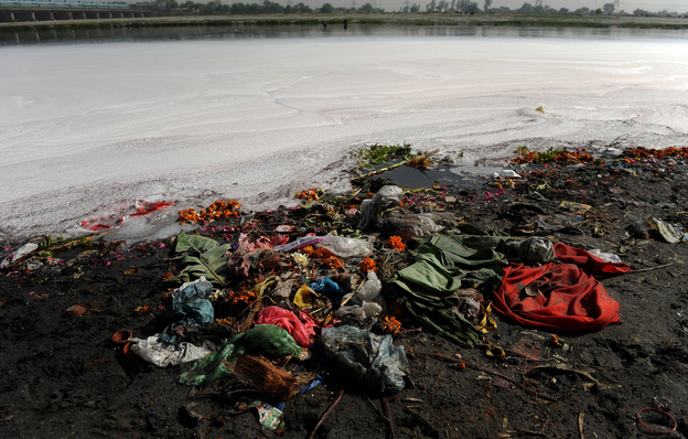 "Garbage litters the banks of India's holy Yamuna River on World Water Day 2010. For decades, the Yamuna has been dying a slow death from pollution. According to Blackwell, even its most ardent defenders refer to it as a ""sewage drain."" (AFP/Getty Images)"