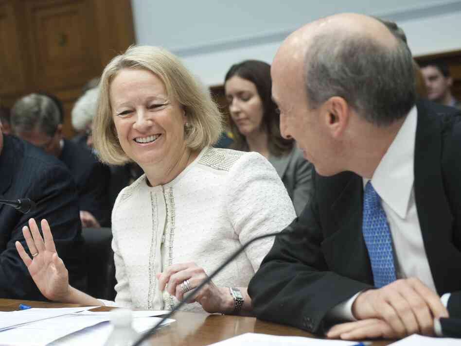 Mary Schapiro, chairman of the Securities and Exchange Commission, and Gary Gensler, chairman of the Commodity Futures Trading Commission, before a June congressional hearing. Both agencies adopted hundreds of pages of rules this week.