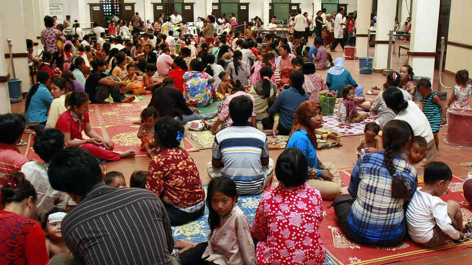 Cambodian children and their parents sitting at Kantha Bopha Children's Hospital in Phnom Penh on July 5.