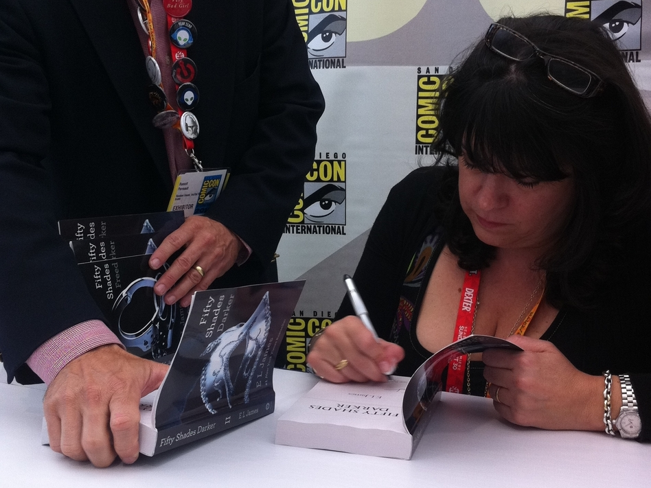 E.L. James signs copies of her book Fifty Shades of Grey at Comic-Con in San Diego on Thursday. (NPR)