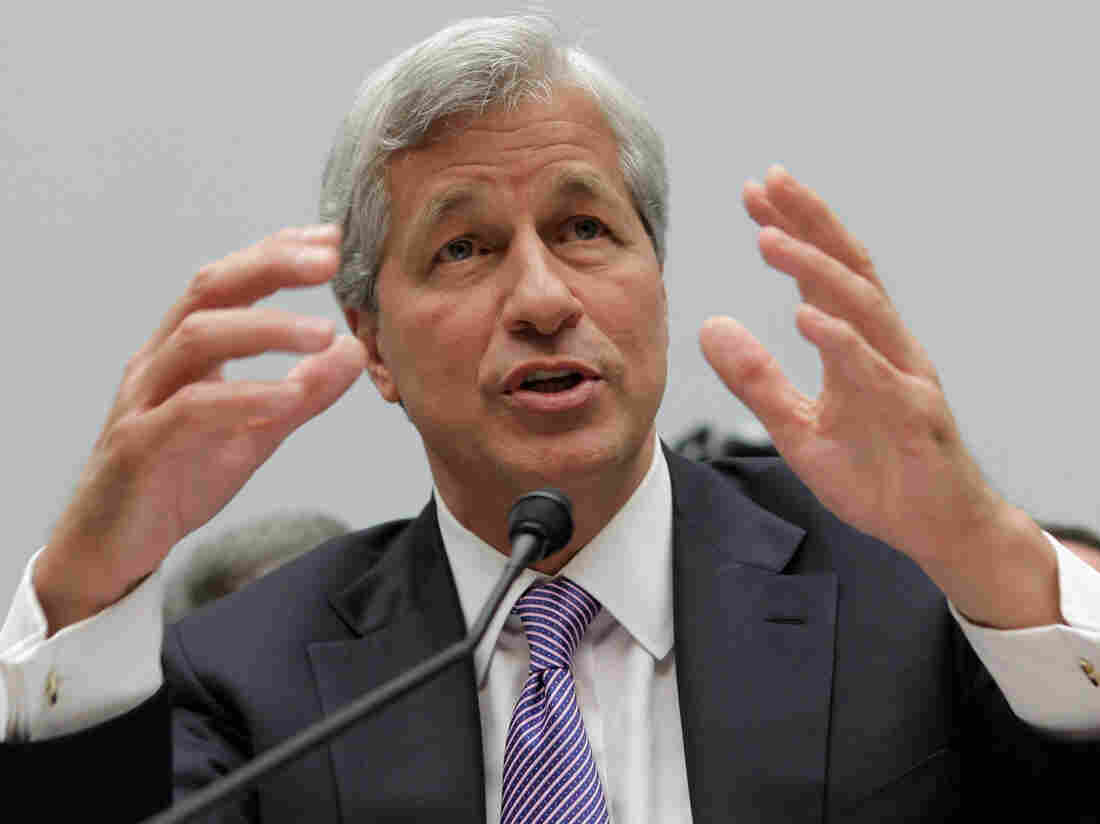 JPMorgan Chase CEO Jamie Dimon, here seen in June testifying before a congressional committee, will try to explain the bank's trading losses to investors on Friday.