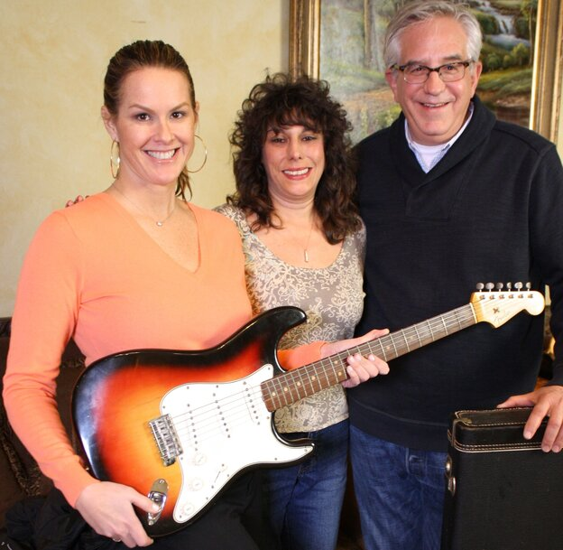 History Detectives' Elyse Luray (left) and Wes Cowan (right), with Dawn Peterson and the guitar Bob Dylan may or may not have played in '65. Peterson says her father came into possession of the famous instrument.
