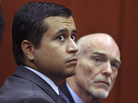 George Zimmerman, left, and attorney Don West appear before Circuit Judge Kenneth R. Lester, Jr. during a bond hearing in June.