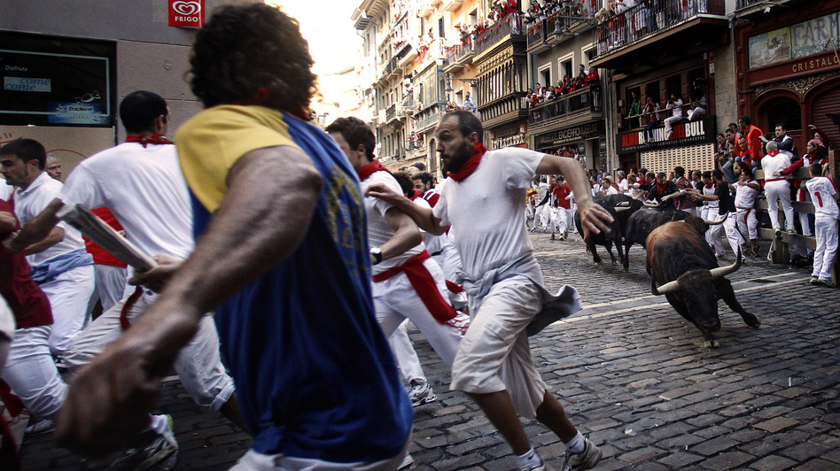 The San Fermin Festival, with its famed running of the bulls, is always a huge fiesta but seasoned locals say the celebrations were a bit muted this year because of Spain's dismal economy. (AP)