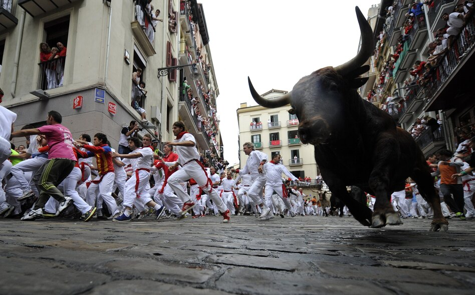 Running with the bulls down narrow cobblestone streets is a timeless tradition. (AFP/Getty Images)