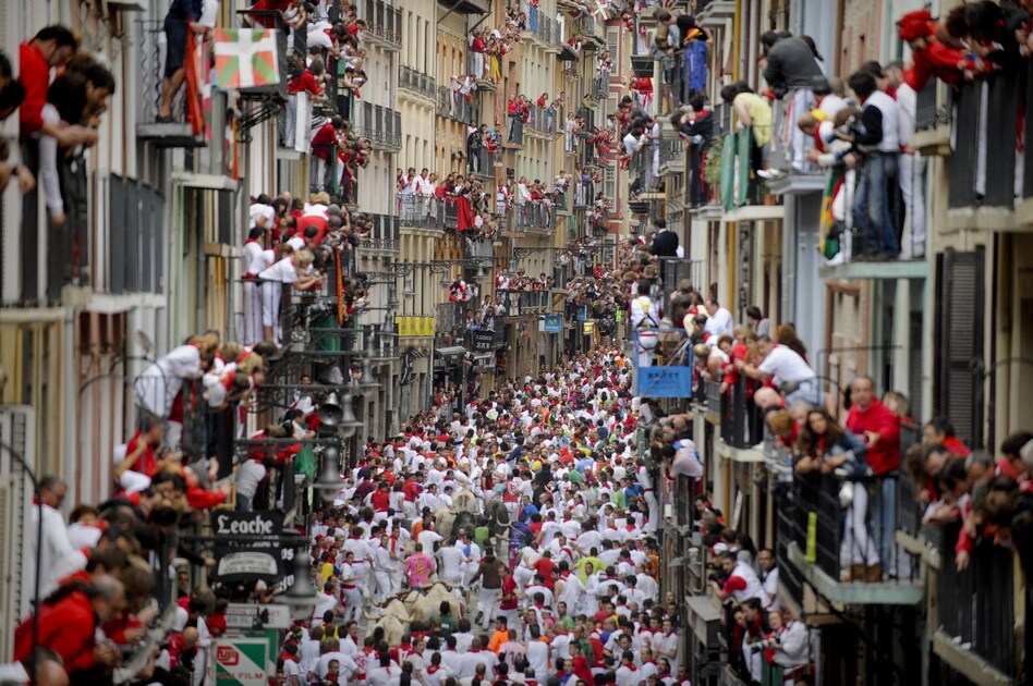 Some revelers drawn to the festival are Ernest Hemingway fans, enchanted by The Sun Also Rises, his 1926 novel that popularized Pamplona's signature fiesta. (AFP/Getty Images)