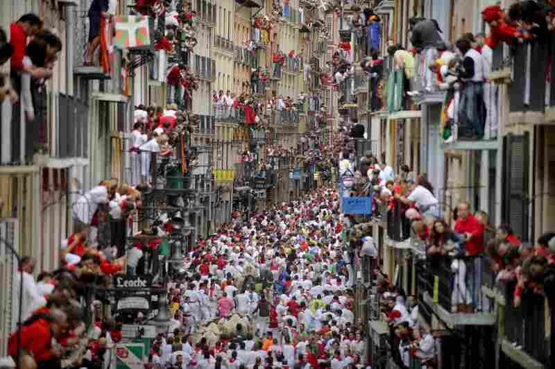 Some revelers drawn to the festival are Ernest Hemingway fans, enchanted by The Sun Also Rises, his 1926 novel that popularized Pamplona's signature fiesta.