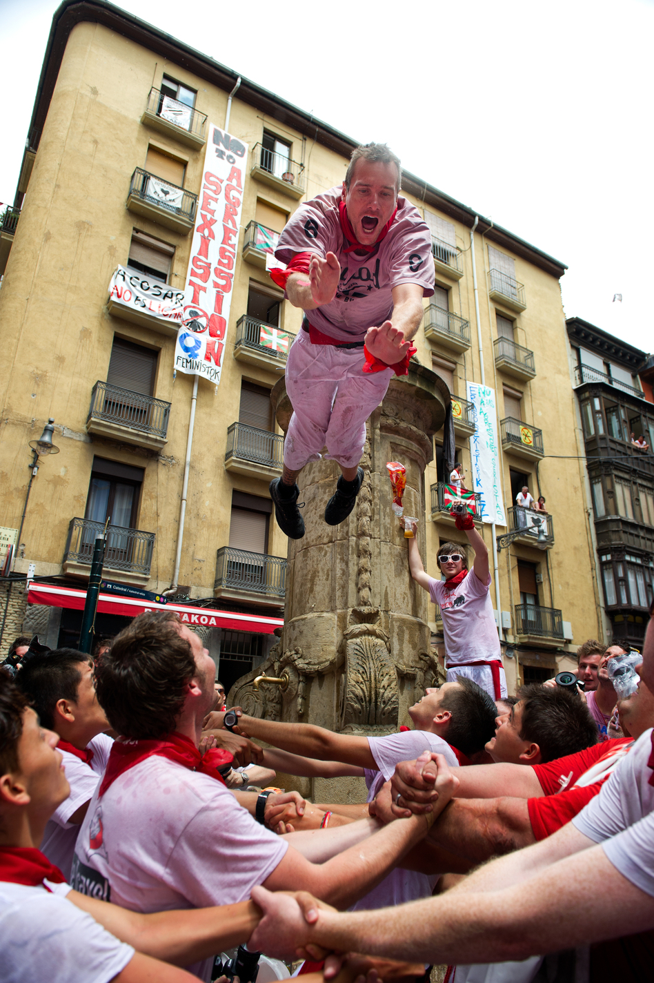 Summertime is Spain's festival season. Villages across the country will honor their patron saints with more wild parties. But come September, a hangover just might be waiting. (Getty Images)