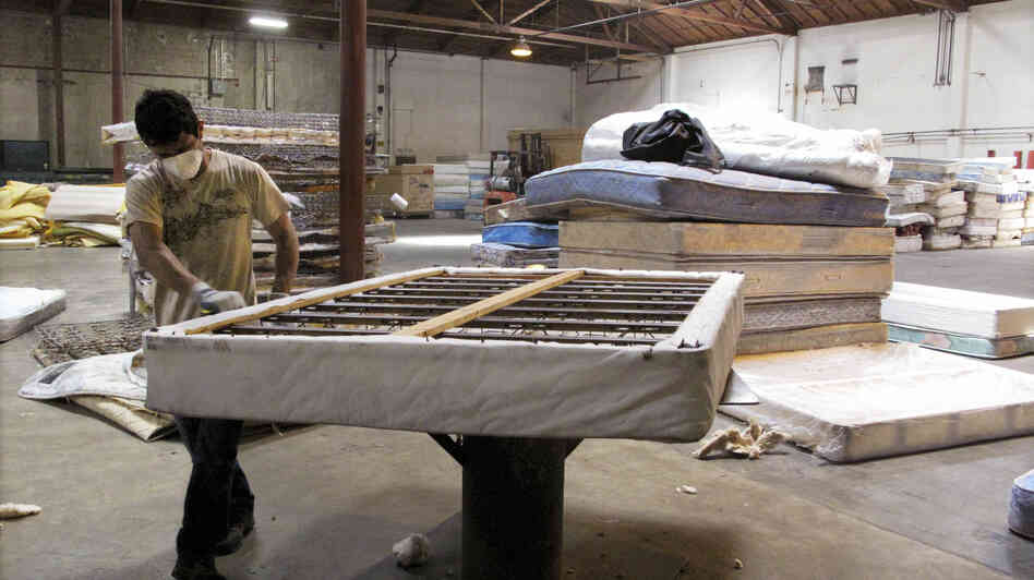 A worker dismantles a mattress at a recycling facility in Oakland, Calif. The material will be used to make carpet products and proceeds will help support the St. Vincent de Paul Society of Lane County, a nonprofit that helps low-income families in Eugene, Ore.
