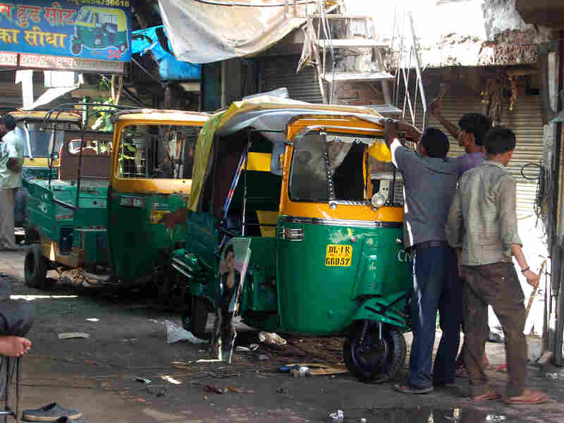 The three-wheeled buggies — a kind of shared taxi — are the most convenient and cheapest way to get around in India. Here, rickshaws are fixed up in New Delhi, India's capital.