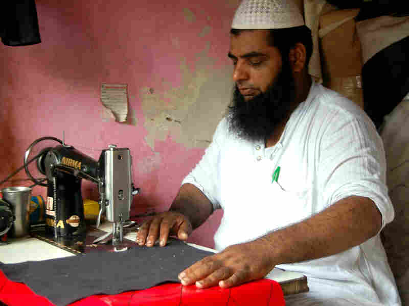 Mohammed Arif makes custom rickshaw seat covers at a market in Delhi that serves as a one-stop shop for the city's rickshaw drivers.